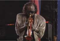 Miles Davis with Carlos Santana – Burn (Live at Amnesty International Concert)